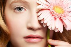 beautiful girl with gerbera - stock photo