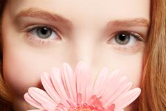 beautiful girl with gerbera - stock photo
