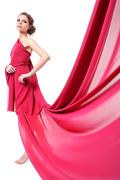 Stock Photo of beautiful woman in red flying dress