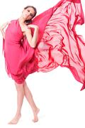 beautiful woman in red flying dress - stock photo