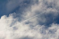 trace of the aircraft in the sky - stock photo