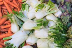 fennel, carrots and  artichokes at local market - stock photo