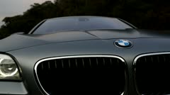 BMW M5 Front Grill and lights turning with Light Flare Stock Footage