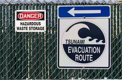 Tsunami Evacuation Sign Next to Power Plant - stock photo