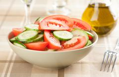 Salad with tomatoes and cucumbers Stock Photos