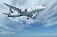 Commercial aircraft in sky Stock Photos