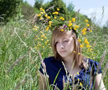 Portrait of a girl with a wreath of yellow flowers on her head Stock Photos