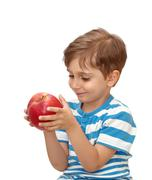 Stock Photo of portrait of a boy with an apple in his hand