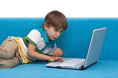 Boy with laptop isolated on white background Stock Photos