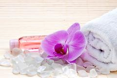 Pink orchid, white towels and bath salts. spa set Stock Photos