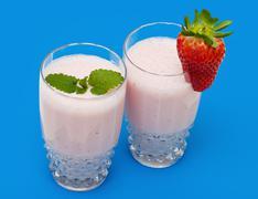 strawberry milkshake on a blue background - stock photo
