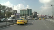 Drive plate, Istanbul into city, oncoming LRT train in centre lane Stock Footage
