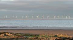 Windturbines in the Irish Sea off hoylake, England Stock Footage