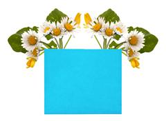 blue space for your text with a bouquet of fresh flowers - stock photo