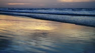 Tide on beach at spectacular sunset Stock Footage