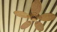 Stock Video Footage of Wooden ceiling fan spinning