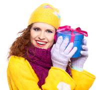 Beautiful happy girl with gift Stock Photos