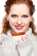 beautiful girl in a cashmere sweater with cup of hot chocolate or coffee or t - stock photo