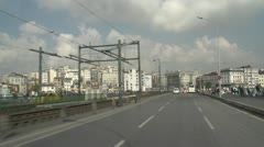 Drive plate, Istanbul into city over bridge and into built up area Stock Footage
