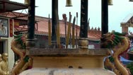 Stock Video Footage of Burning incense sticks in a Buddhist censer.
