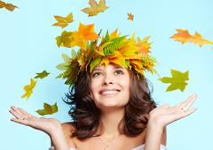 young woman and leaf fall - stock photo