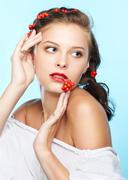 Beautiful brunette with ashberries Stock Photos