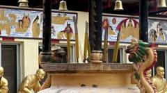 Burning incense sticks in a Buddhist censer. Stock Footage