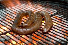 tradtional south african braai barbecue borewors sausage on fire - stock photo