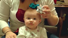 Christmas bows on baby's head 2 - stock footage