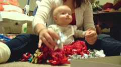 Christmas bows on baby's head - stock footage
