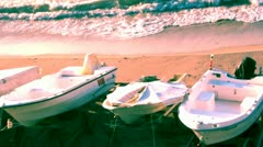 WAVES and BOATS ON THE SHORE Stock Footage