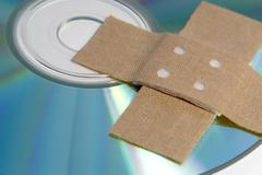 Adhesive plaster and cd rom detail Stock Photos