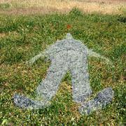 Human figure imprinted on grass Stock Photos
