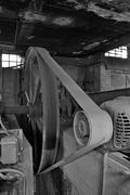 belt driven machinery in abandoned factory - stock photo