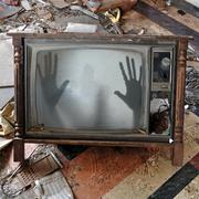 Ghost appears on flickering tv set Stock Photos