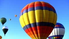 Hot air balloons against a brights blue sky 12 Stock Footage