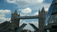 Stock Video Footage of Tower Bridge in London closing the bascules