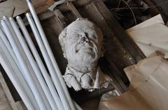 Broken sculpture head of adult man Stock Photos