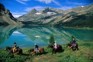 Stock Photo of 4 horse riders with Mountain Lake