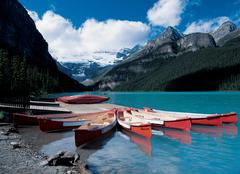 Canoes at Lake Louise - stock photo