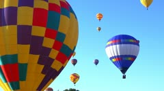 Hot air balloons against a brights blue sky 10 Stock Footage