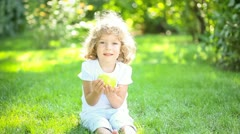 happy child eating apple - stock footage