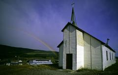 Rural church w/ rainbow at door Stock Photos