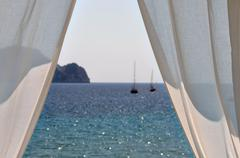 White curtains boats by the sea Stock Photos