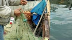 Fisherman repairing fishnets Stock Footage