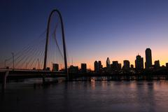 Dallas skyline and Bridge in Silhouette at sunrise intense sky Stock Photos