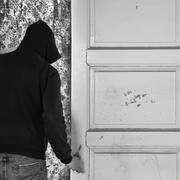 man exiting through door - stock photo