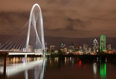 Dallas Night Skyline w/ Margaret Hunt Hill Bridge reflecting in River Stock Photos