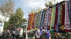 Football scarves on a display line Stock Footage