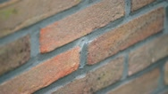 Stock Video Footage of Drilling a hole in a cavity wall to inject insulation